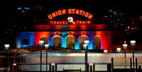A light-rail train arrives at Denver's Union Station. The station is lit for the holiday season.