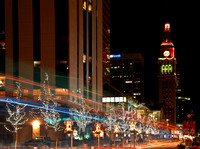 Denver's 16th Street mall lit for the holidays. A bus zipped through the image leaving the streaking lights.