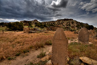 Threatening clouds move in over a small cemetary at a ruined 19th-century Spanish mission in the Purgatoire River valley.